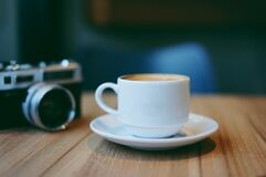 Coffee cup and camera Stock Photo