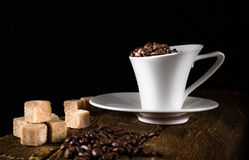 coffee cup and cane sugar Stock Photos