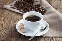 Coffee cup with cane sugar Stock Image