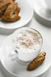 Coffee cup with cantuccini Stock Images