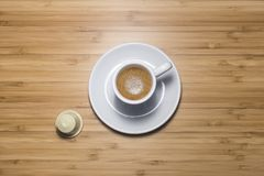 Coffee cup and capsule. Coffee cup on a wooden shelf, tilt view Stock Photos
