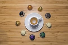 Coffee cup and capsules. Every time is good for a coffee break Stock Images