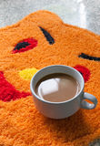 Coffee cup on carpet. Coffee cup on orange carpet fancy Royalty Free Stock Photo