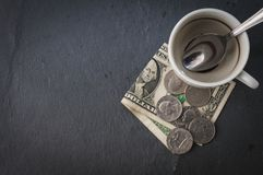 Coffee cup and cash Royalty Free Stock Images