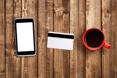 Coffee cup, cell phone and plastic card Royalty Free Stock Photos