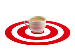Coffee cup in the center of red target Stock Photography