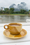 Coffee cup ceramic with Song river (Vang Vieng Laos) and cloud b Royalty Free Stock Photo