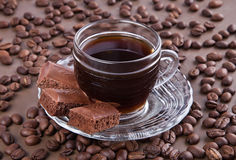 Coffee cup and chocolate. Coffee cup, coffee beans and chocolate Royalty Free Stock Photo