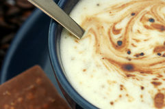 Coffee cup and chocolate. Coffee cup (detail), served with a chocolate bar stock photo