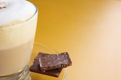 Coffee cup and chocolate bar Stock Photos