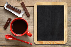 Coffee cup with chocolate and blackboard Stock Photography