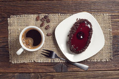Coffee cup and chocolate cake with cherry jelly Stock Photography