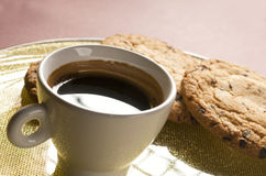 Coffee cup and chocolate cookies Stock Photo
