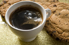 Coffee cup and chocolate cookies Stock Photos