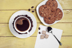 Coffee cup and chocolate cookies Stock Images