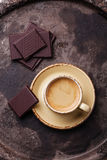 Coffee cup with chocolate. On dark textured background Stock Images