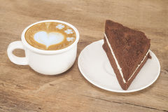 Coffee cup and chocolate dessert cake Stock Image