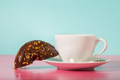 Coffee cup with chocolate donuts Royalty Free Stock Photo