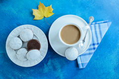 The coffee cup with chocolate gingerbreads with white glaze. Autumn maple leaf. Stock Photo