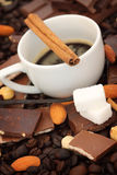 Coffee cup, chocolate with hazelnuts Stock Photos