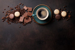 Coffee cup, chocolate and macaroons on old kitchen table Royalty Free Stock Photo