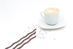 Coffee cup and chocolate sticks Royalty Free Stock Images