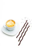 Coffee cup and chocolate sticks Stock Photos