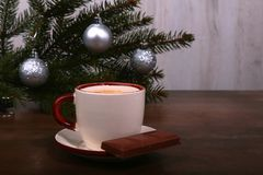 Coffee cup and chocolate on wooden table texture. Coffeebreak. Christmas time.  royalty free stock photos