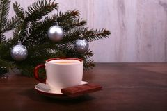 Coffee cup and chocolate on wooden table texture. Coffeebreak. Christmas time stock photos