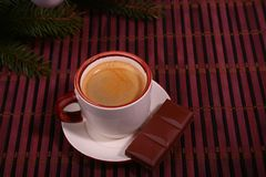 Coffee cup and chocolate on wooden table texture. Coffeebreak. Christmas time.  royalty free stock image