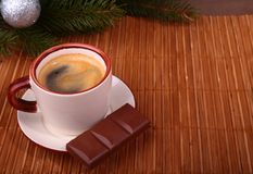 Coffee cup and chocolate on wooden table texture. Coffeebreak. Christmas time.  royalty free stock photography