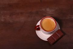 Coffee cup and chocolate on wooden table texture. Coffeebreak.  stock images