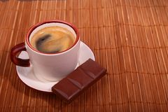 Coffee cup and chocolate on wooden table texture. Coffeebreak.  royalty free stock photos