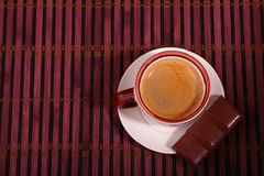 Coffee cup and chocolate on wooden table texture. Coffeebreak.  royalty free stock photo