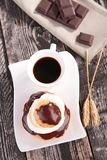 Coffee cup and choux pastry Royalty Free Stock Photos
