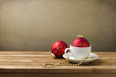 Coffee cup with Christmas decorations Stock Photos