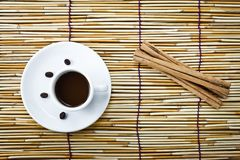 Coffee in cup and cinnamon Stock Photos