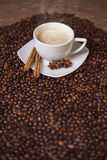 Coffee cup with cinnamon and anise Stock Photo