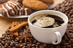 Coffee cup, cinnamon, anise and sweets Stock Photo