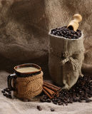 Coffee cup cinnamon coffee beans Royalty Free Stock Images