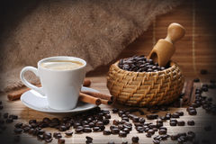 Coffee cup cinnamon coffee beans Royalty Free Stock Image