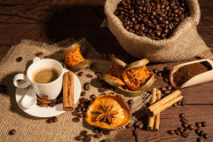 Coffee cup with cinnamon, star anise and dried orange fruit Royalty Free Stock Photo