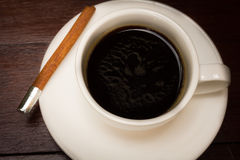 Coffee cup with cinnamon stick. Stock Photography