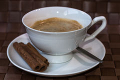 Coffee cup  with cinnamon sticks Royalty Free Stock Images