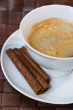 Coffee cup  with cinnamon sticks Stock Photos
