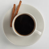Coffee cup with a cinnamon sticks Royalty Free Stock Images