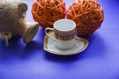 Coffee cup and clay vessel background Stock Image