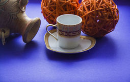 Coffee cup and clay vessel Royalty Free Stock Image