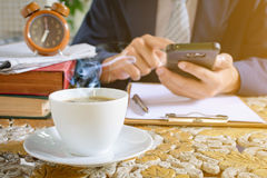 Coffee cup clock and newspaper work on table Stock Photos