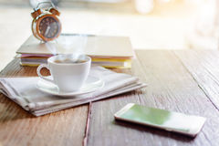 Coffee cup clock and work on table Stock Photos